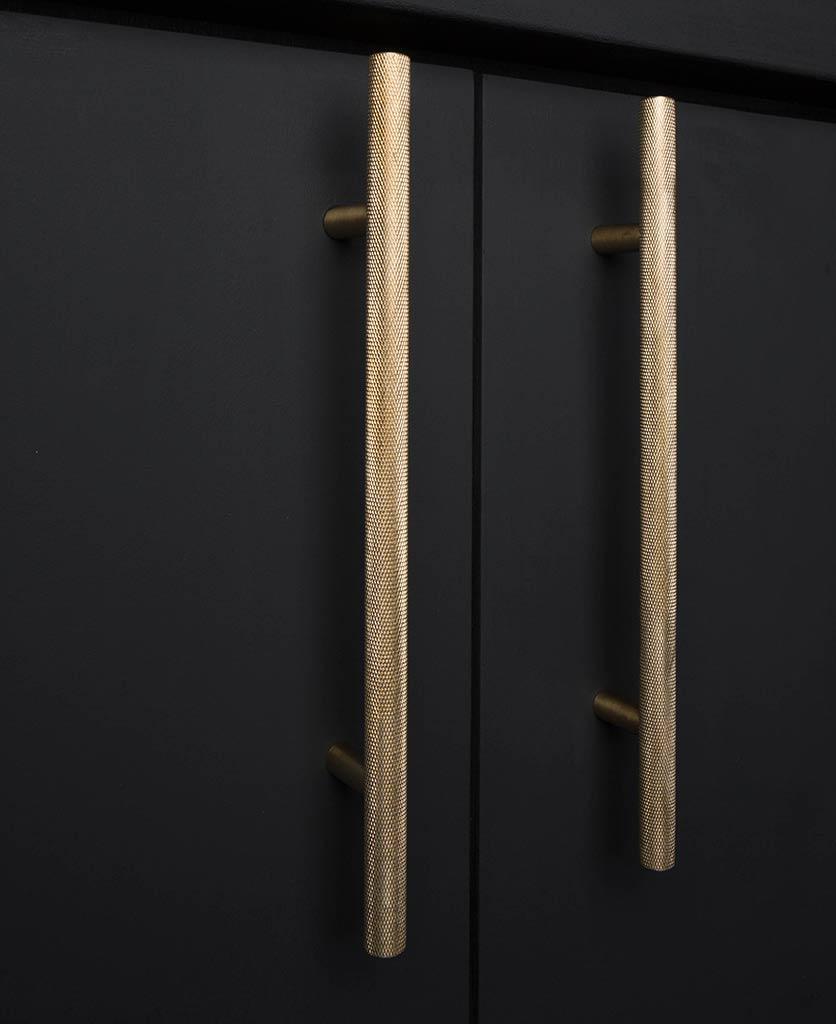 brass skyscraper cupboard handles on black cupboard