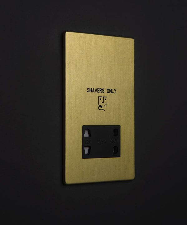 gold & black shaver socket against black background
