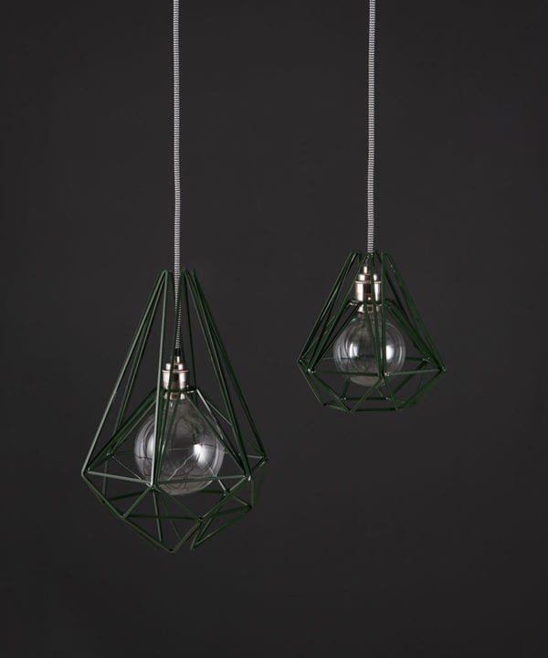 metal cage light matcha two black metal diamond shaped cage light shades with silver bulb holders suspended from black and white fabric cable against dark grey wall