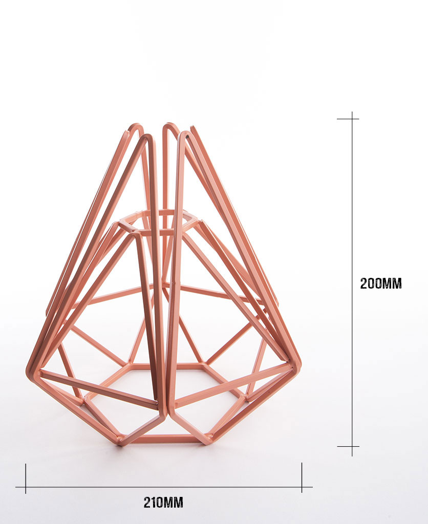 Pink cage table lamp shade on white background with dimensions height 200m width 210mm