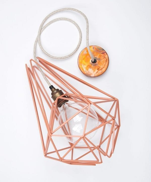 pink cage pendant light flat lay