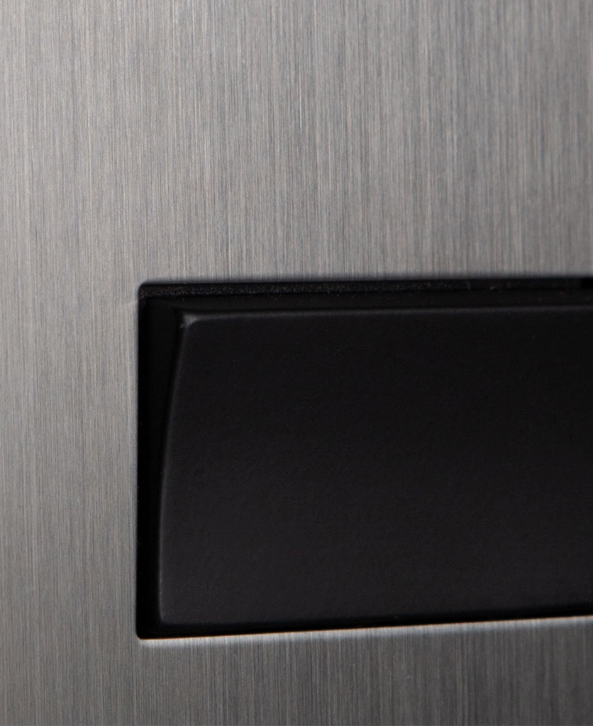 closeup of silver and black fan switch
