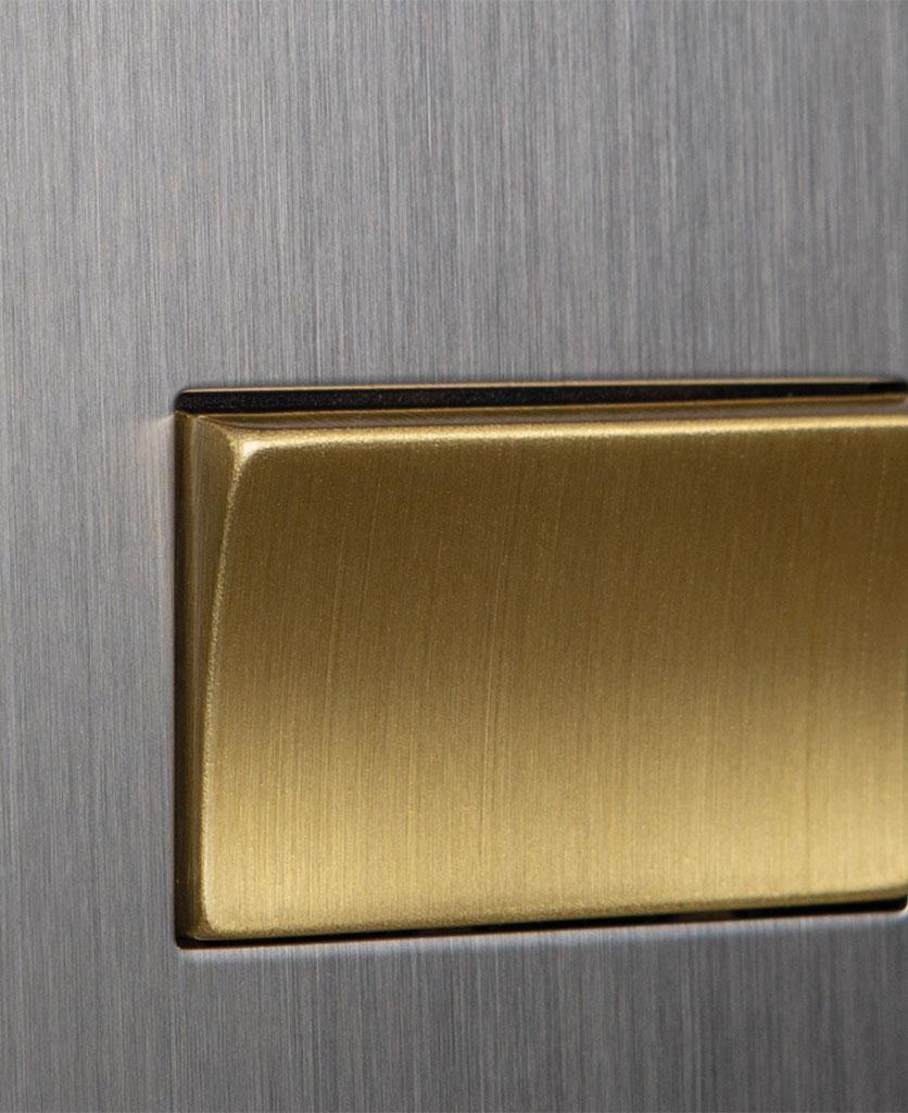 closeup of silver and gold fan switch