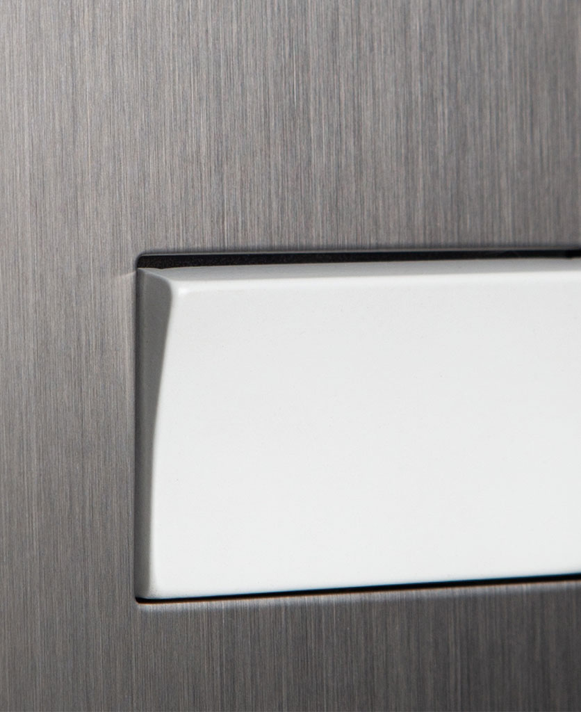 closeup of silver and white fan switch