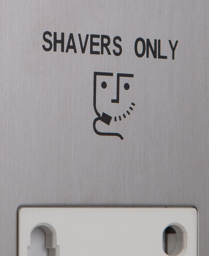closeup of silver and white shaver socket