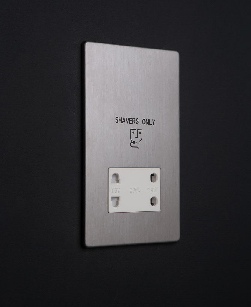 silver and white shaver socket against black background