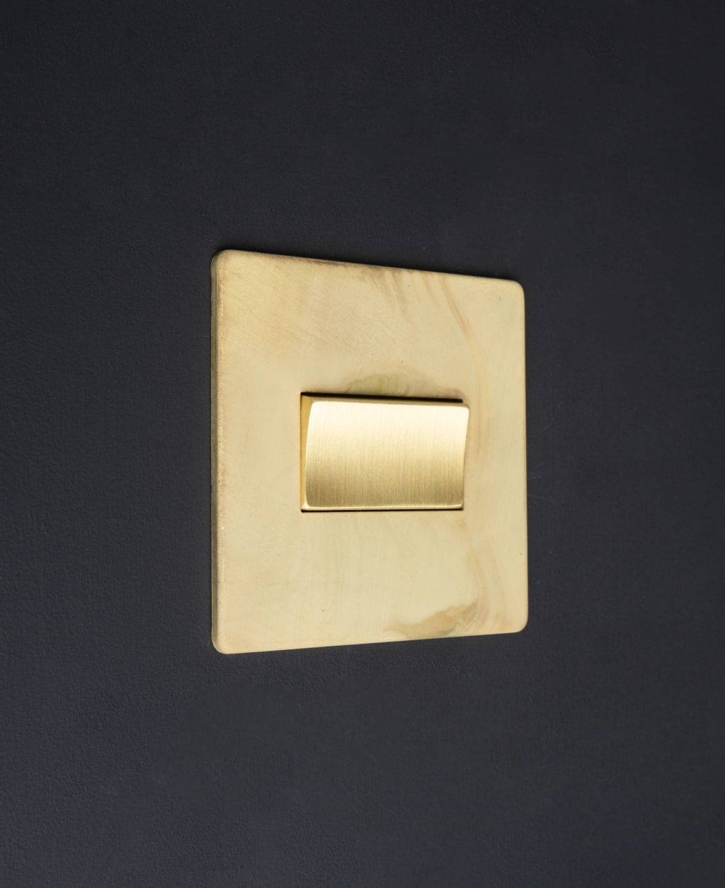 smoked gold and gold fan switch against black background