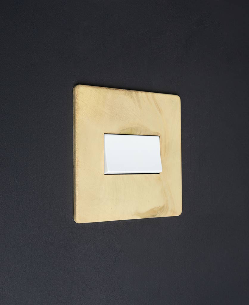 smoked gold and white fan switch against black background