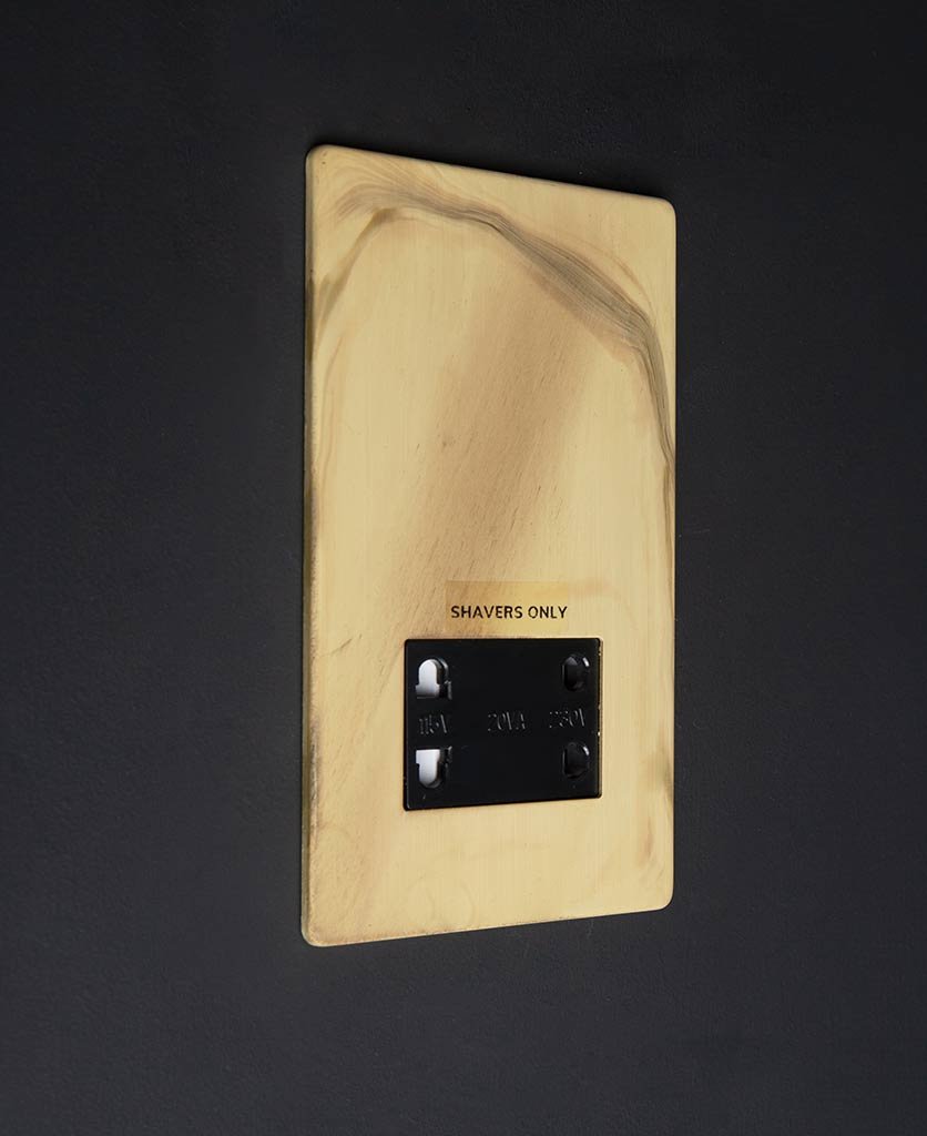 Smoked Gold Shaver socket with black insert against black background