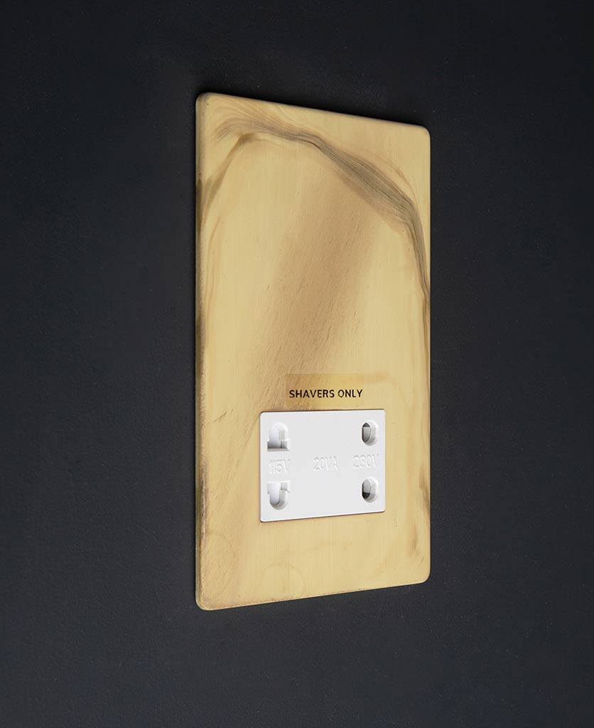 Smoked Gold Shaver socket with white insert against black background
