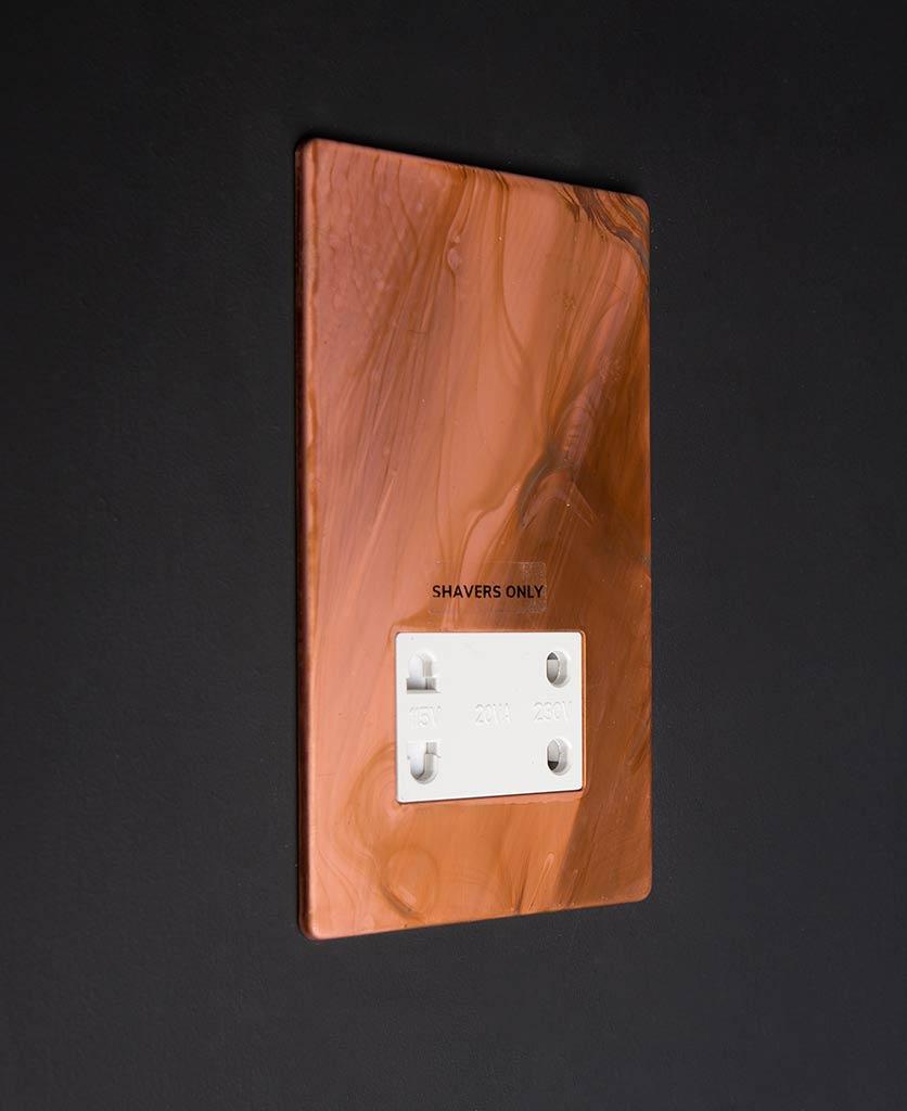 Tarnished Copper Shaver socket white insert against black background