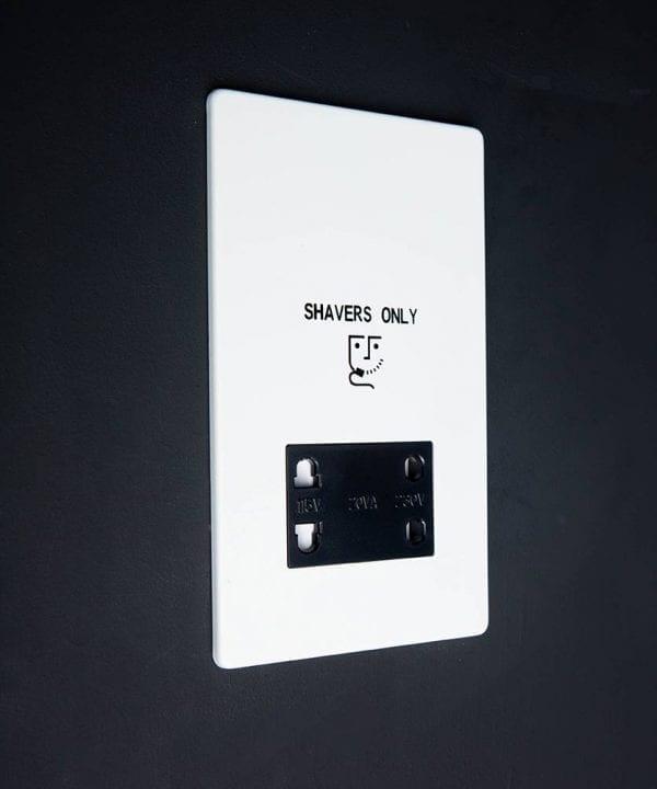 White shaver socket with black insert