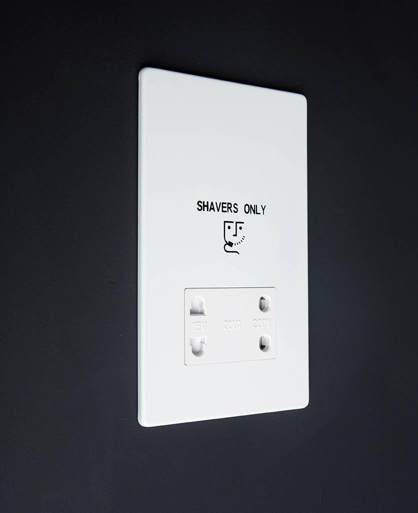 white shaver socket against black background