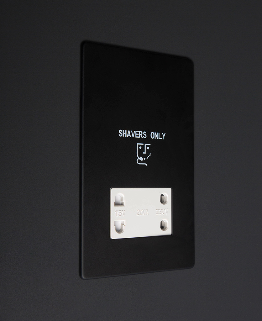 black and white shaver socket against black background
