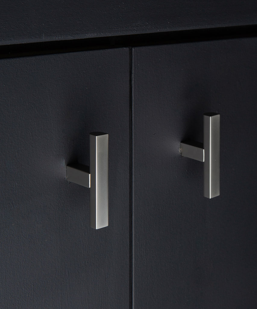 taipei silver t-bar handle attached to a black cupboard