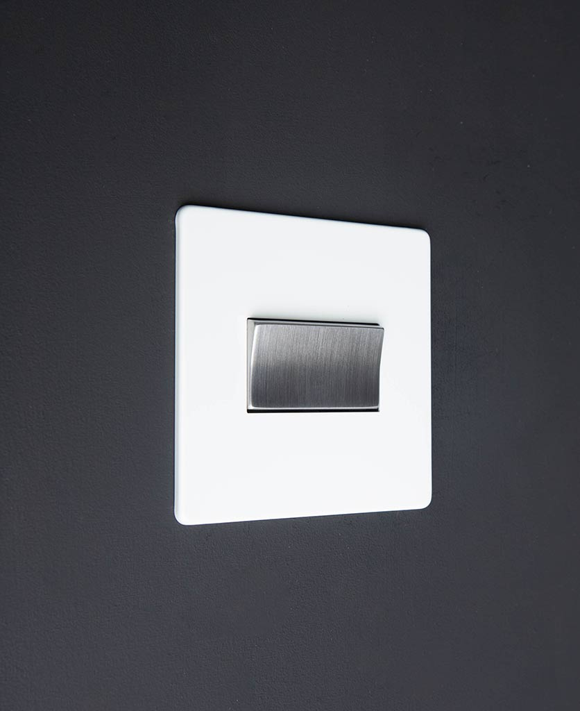 white and silver fan switch against black background