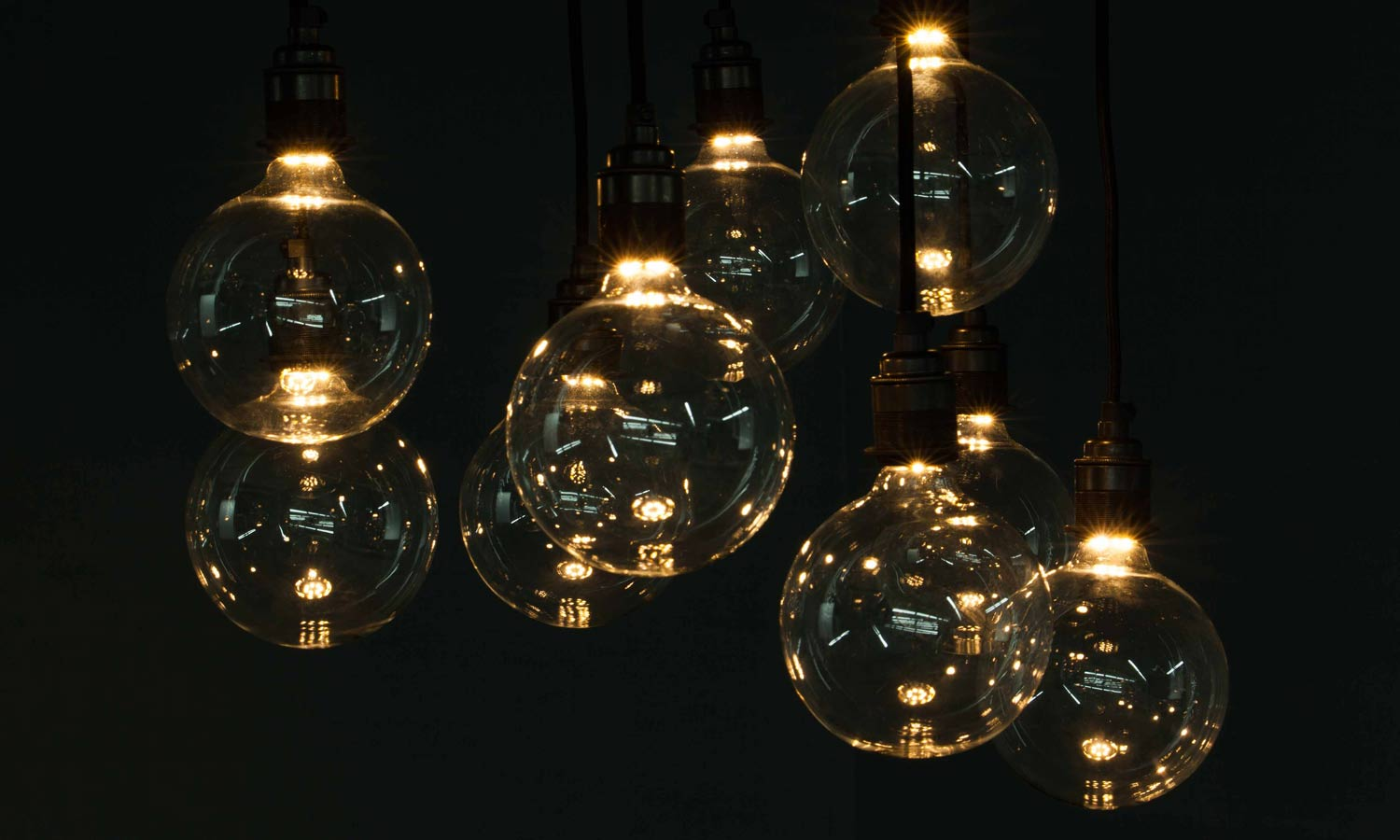 cluster of concealed filament globe bulbs against black background