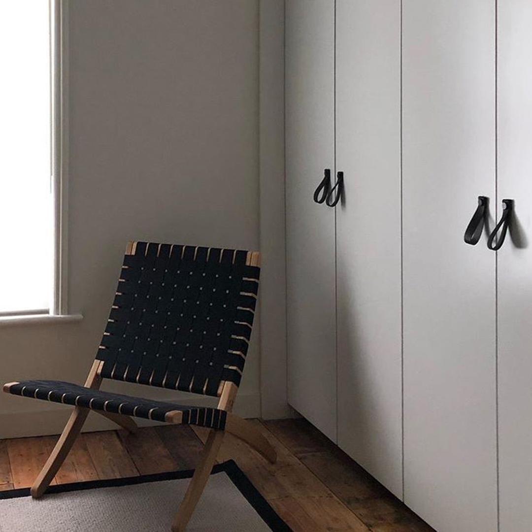 large black magni handle on white wardrobe doors