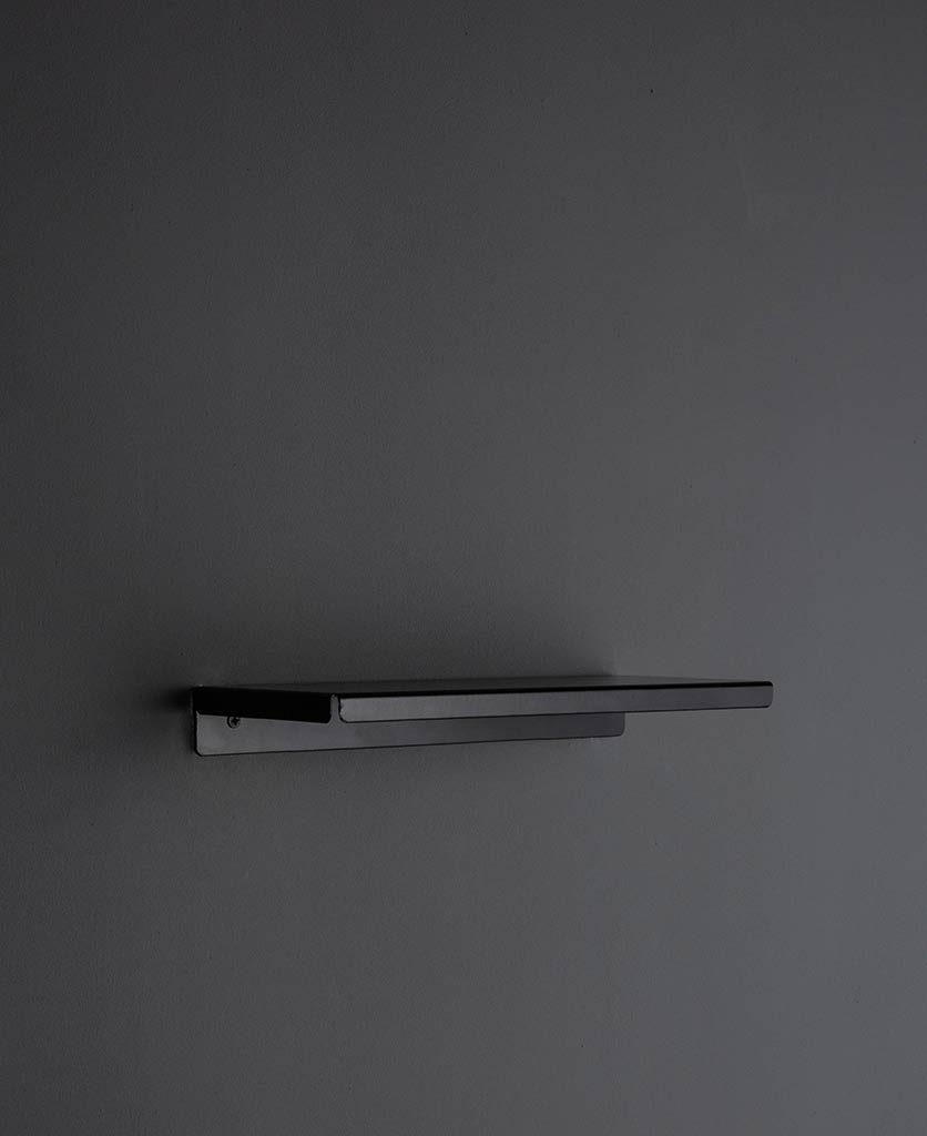 assam metal shelf on grey wall