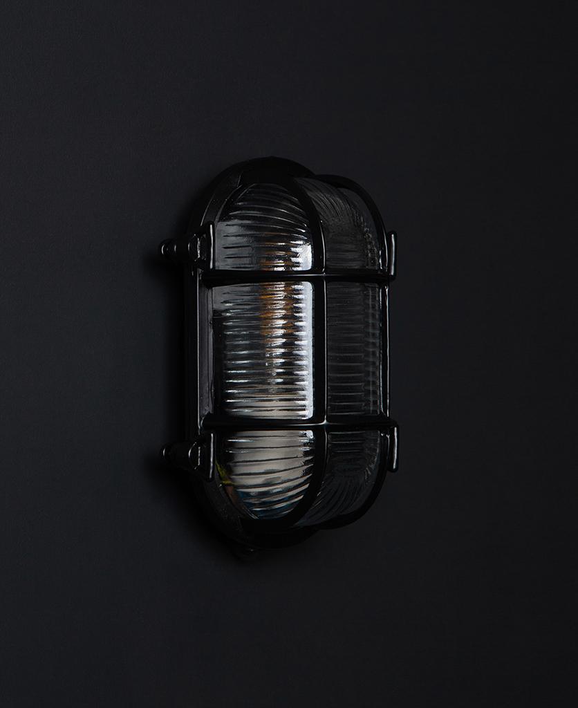 steve unlit black bulkhead light with wingnuts against black background