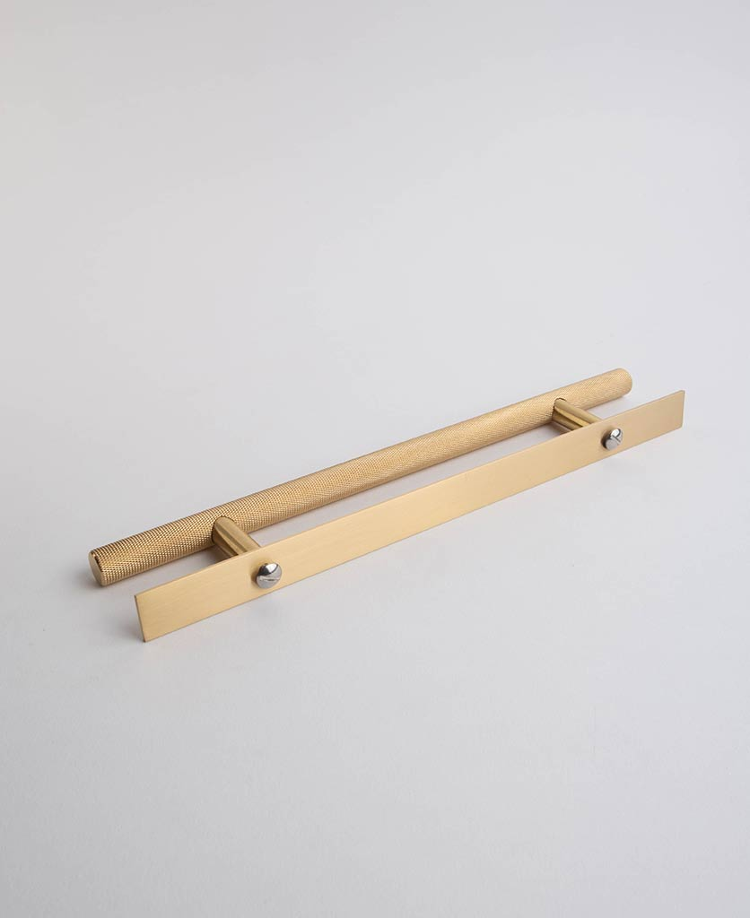 brass skyscraper handle with plate against white background