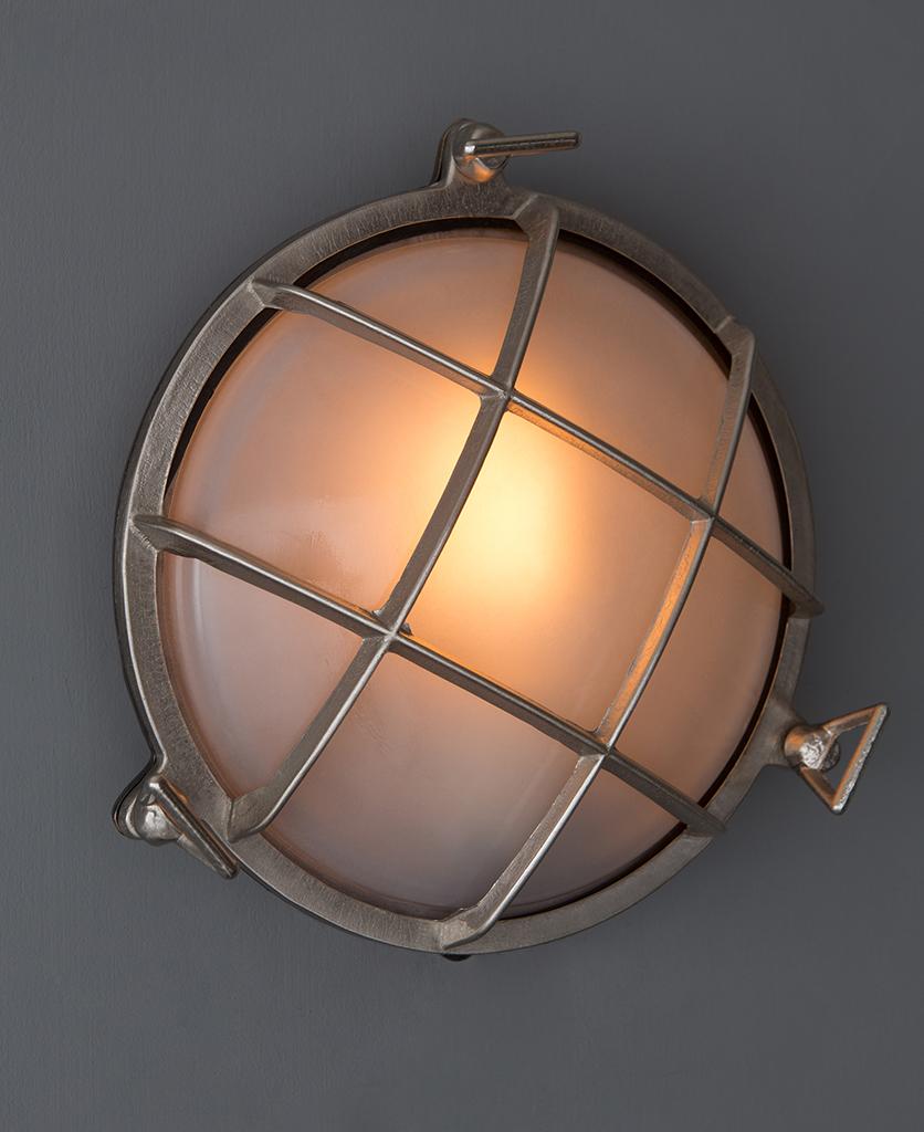 lit chris silver bulkhead led light against grey wall