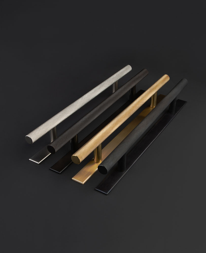 Brass kitchen handles with plate