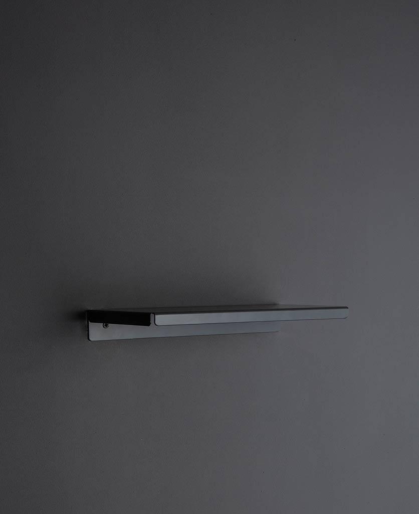 earl grey metal wall shelf against grey background