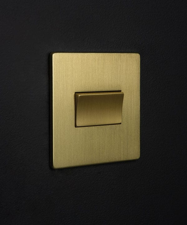 gold fan switch against black background