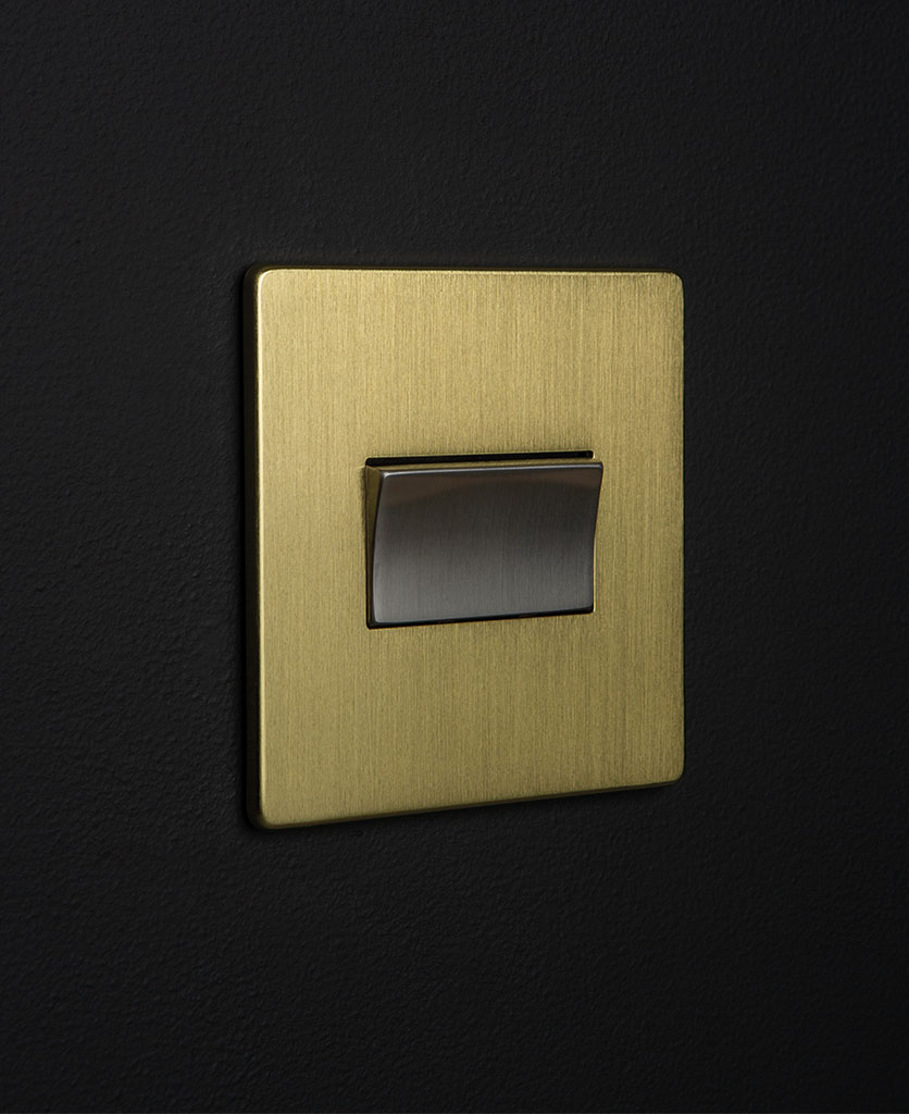 gold and silver fan switch against black background