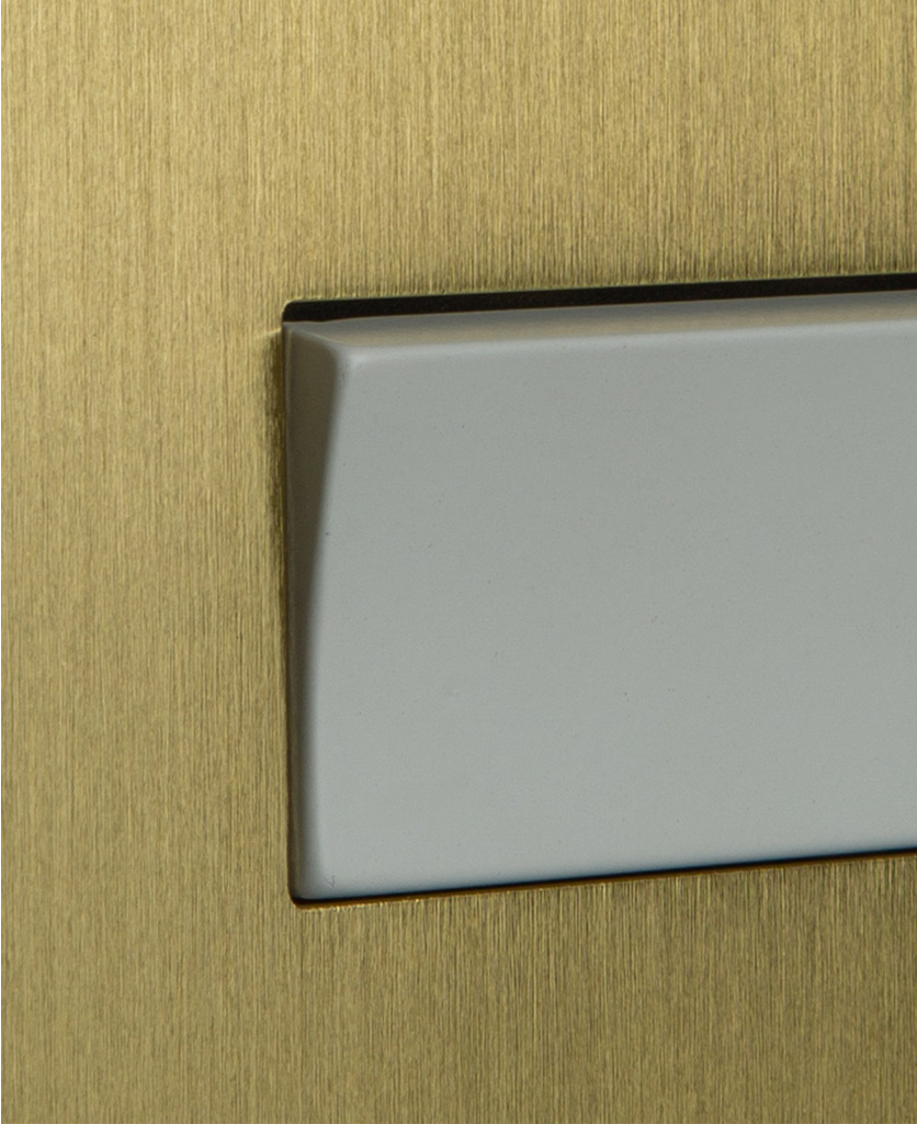 closeup of gold and white fan switch