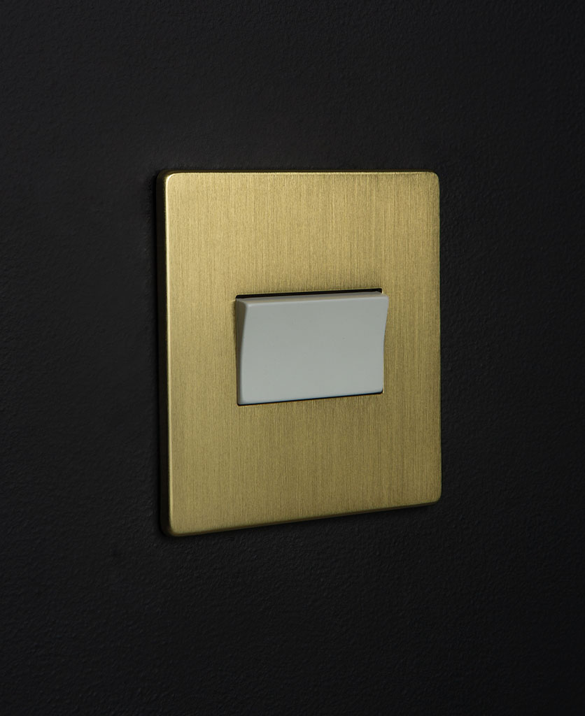 gold and white fan switch against black background