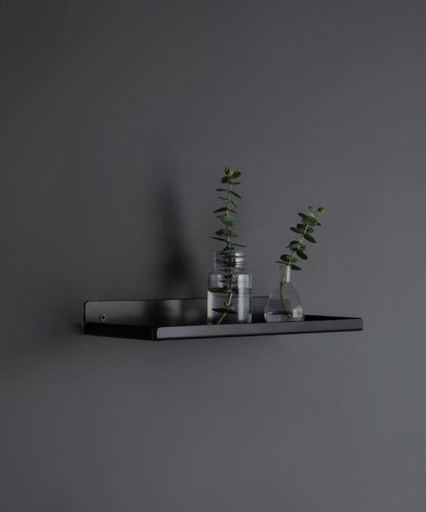 assam black shelf with glass vases on a dark grey wall