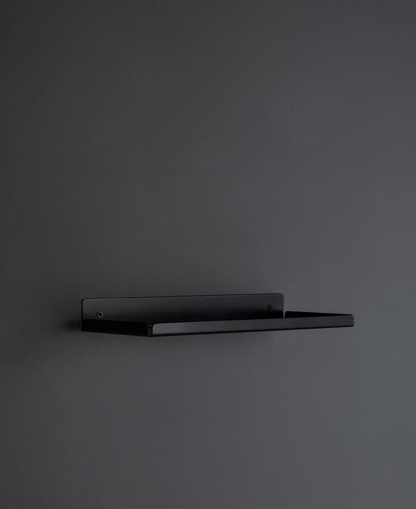 assam black metal wall shelf on a dark grey wall