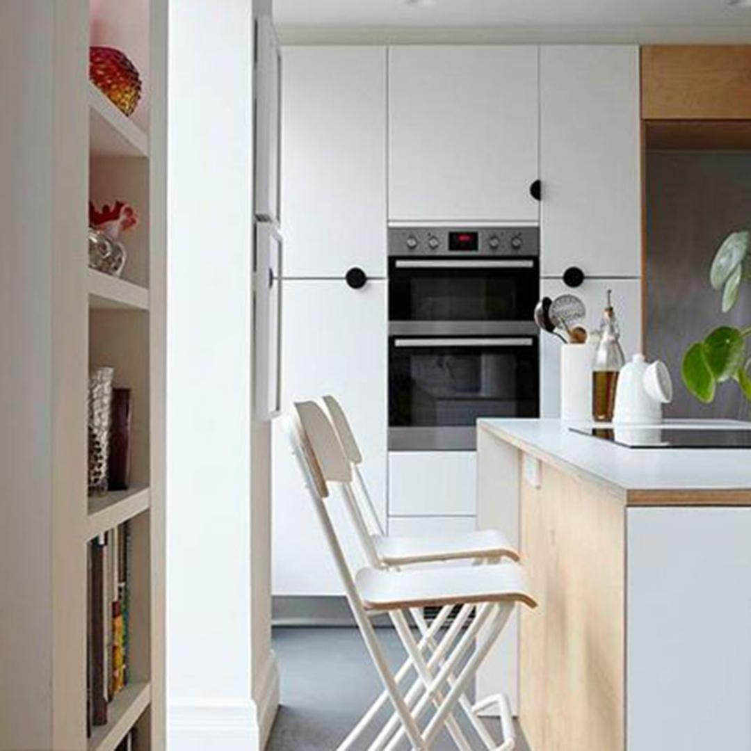 mezzaluna black door handle on white cupboards in a kitchen
