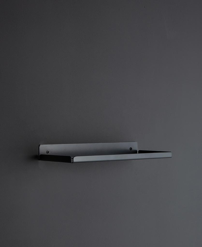 earl grey wall shelf on a dark grey wall