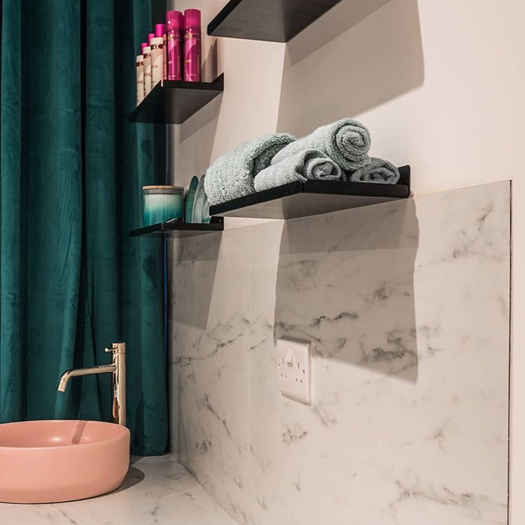 assam shelf in a pink, white and marble bathroom