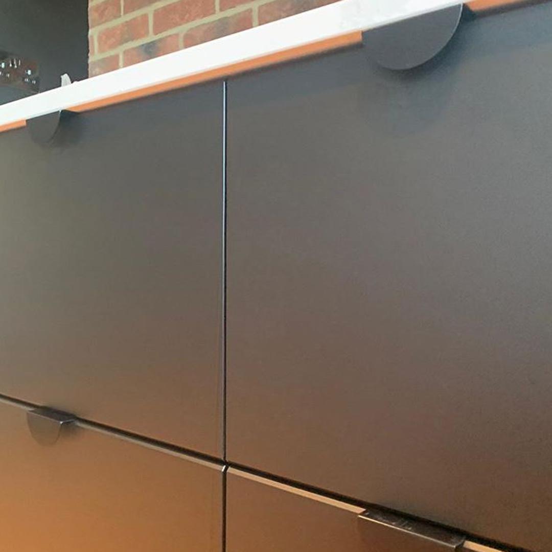 black mezzaluna door handles on black drawers