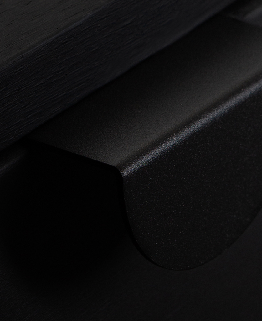closeup of mezzaluna pull handle in black on black drawer