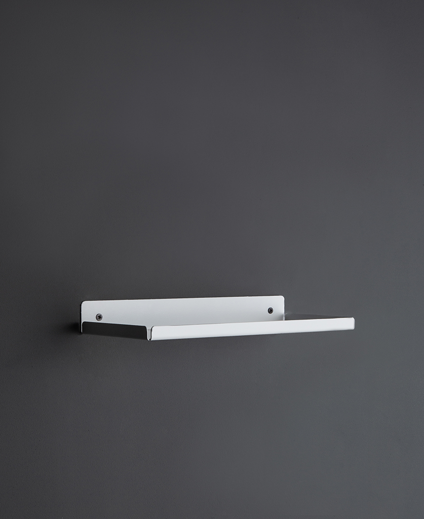 white metal wall shelf on a dark grey wall