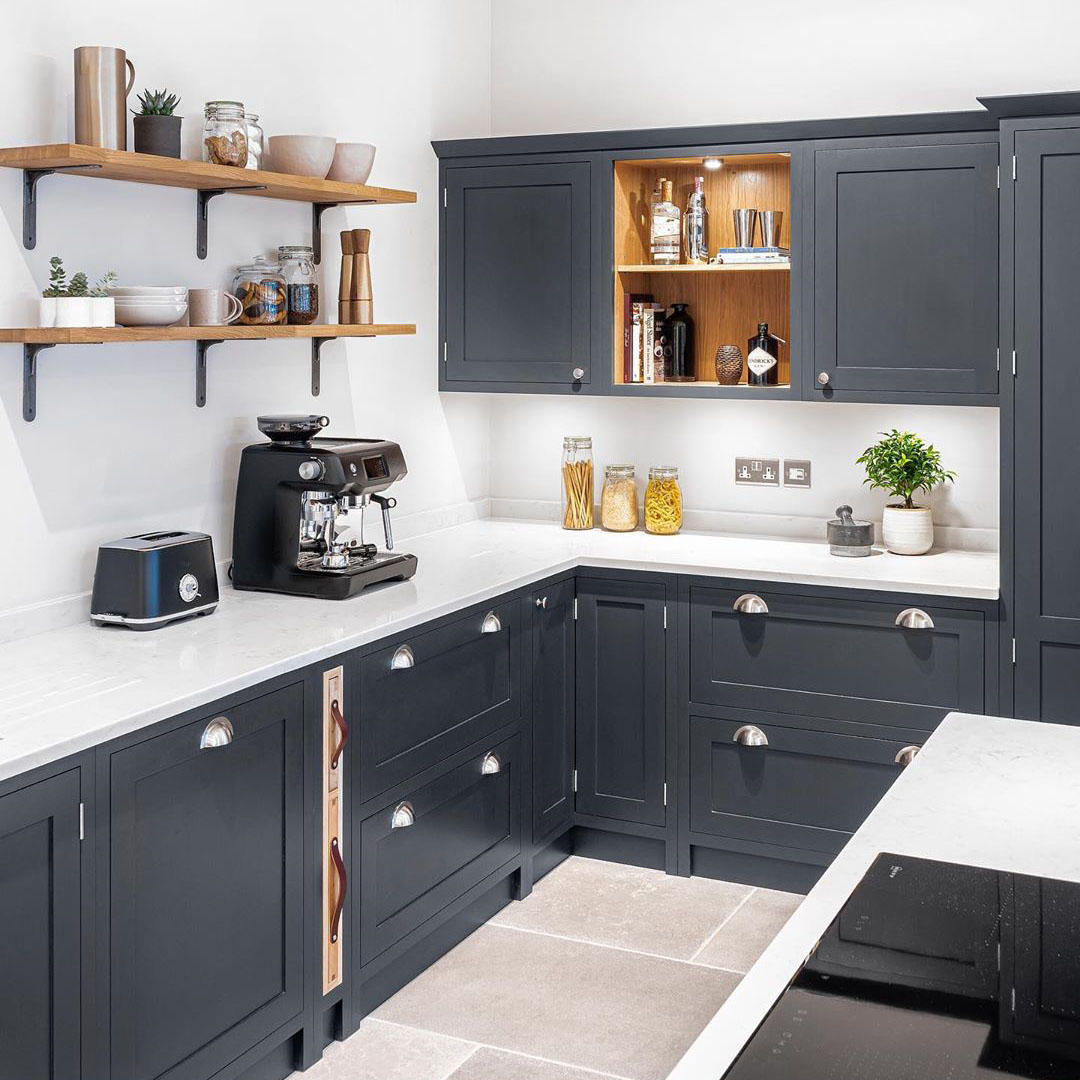 magnus shelf bracket used as open shelving in a dark grey and white kitchen