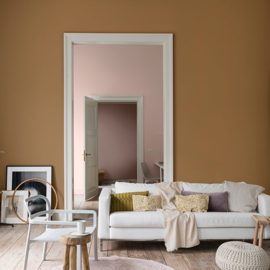 spiced honey living room with white sofa and wooden floorboards
