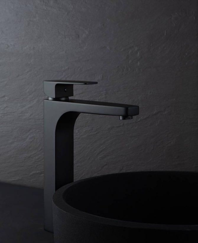 Kalandula matt black bathroom mixer tap next to black sink on black background