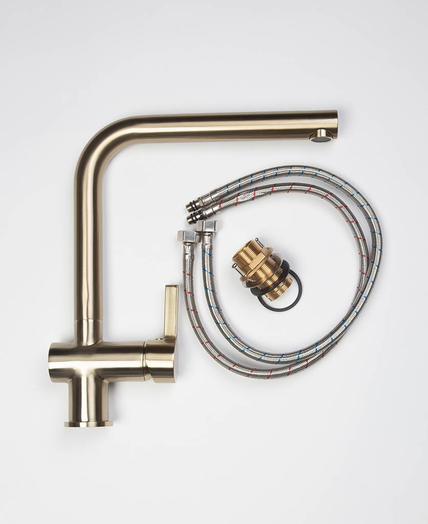 Kintampo gold kitchen tap with connecting flexi-hose and components flat lay