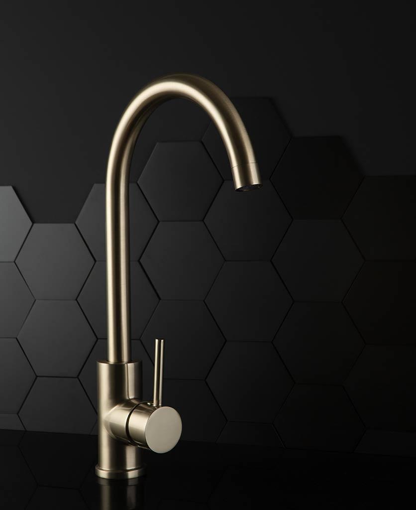 Tinkisso gold kitchen sink tap on black background