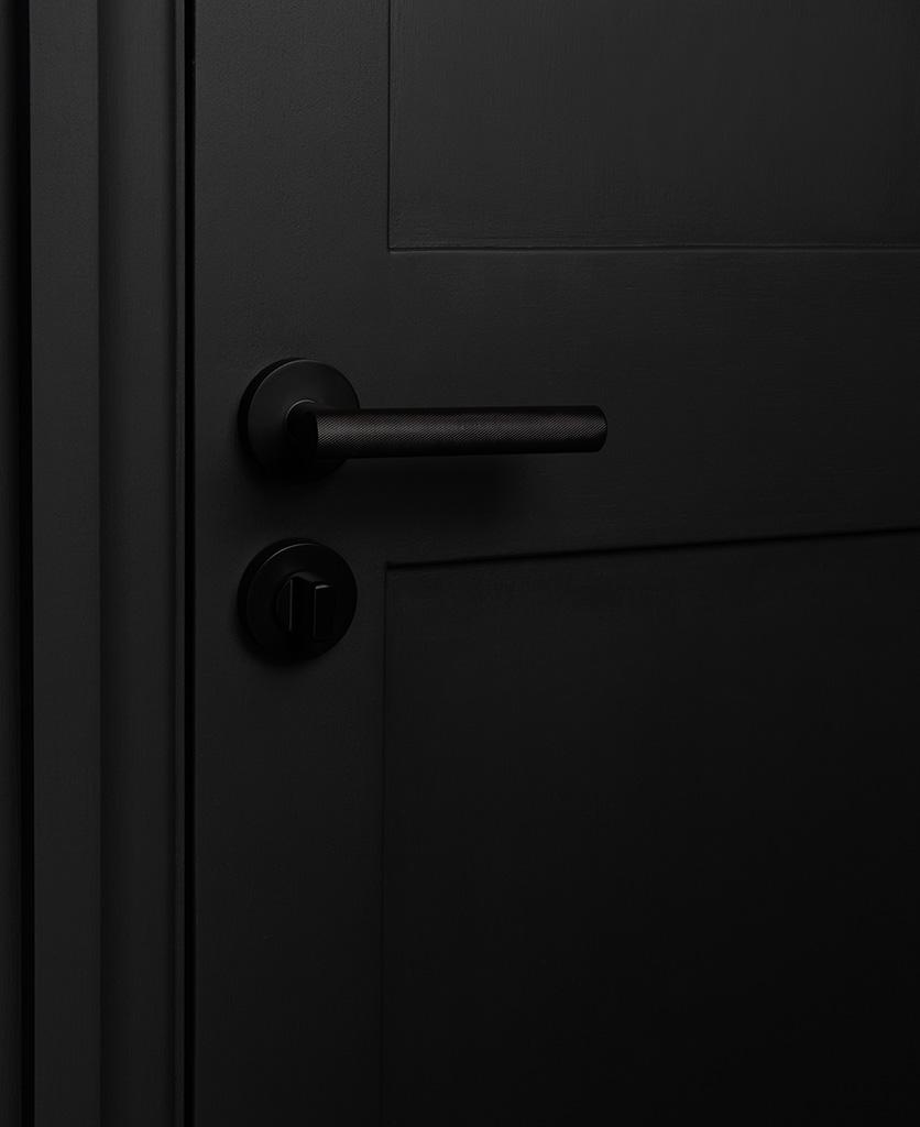 hirst black modern door handle with thumb lock on black door