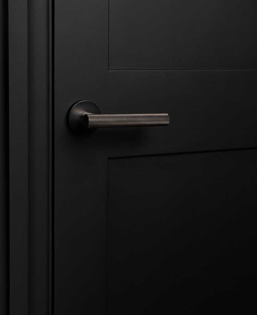 hirst graphite modern door handle on black door