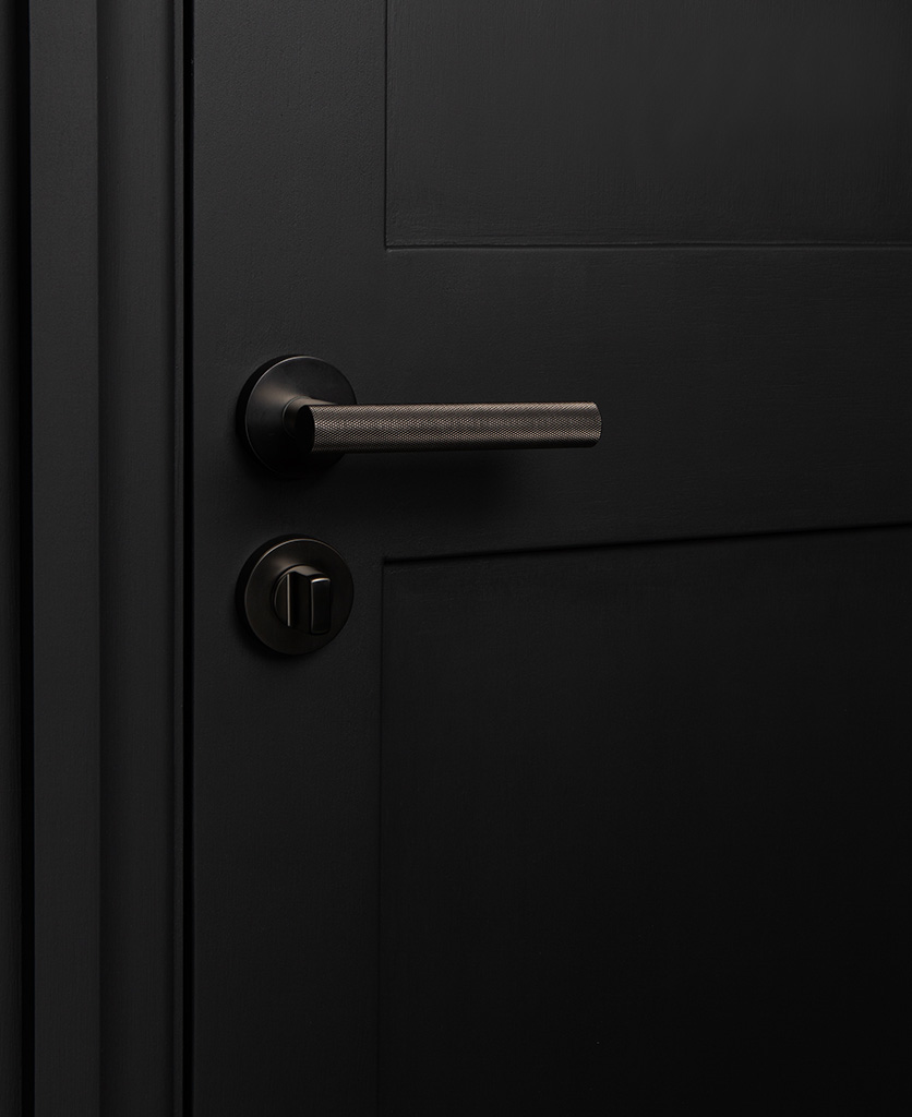 hirst graphite modern door handle with thumb lock on black door