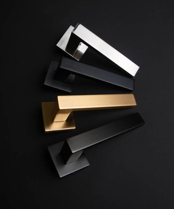 hockney lever door handle group shot with gold, silver, graphite and black handles on black background