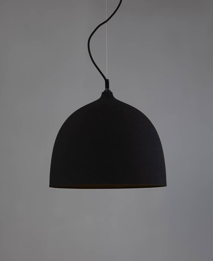 large basque pendant light against grey wall